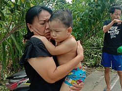 Mother jumps into 30m well to save son