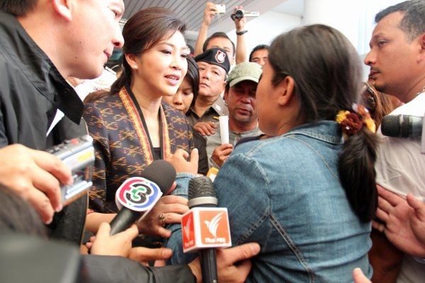 Yingluck says she 'sometimes' thinks like her brother