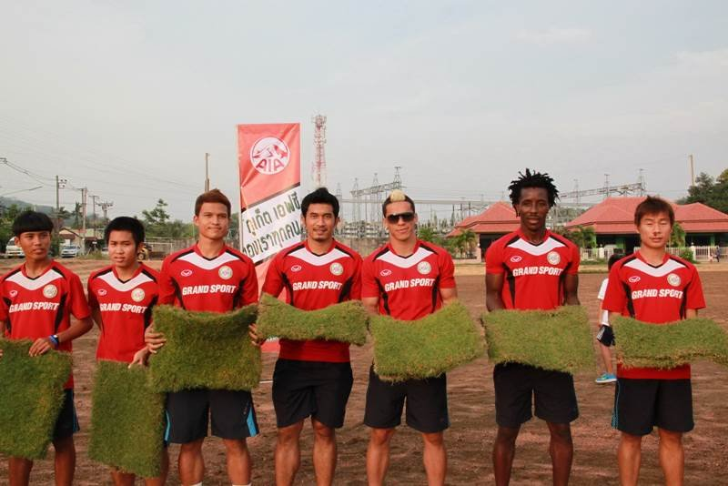 Some of the Phuket FC squad laying the first turf on their new pitch in Chalong.