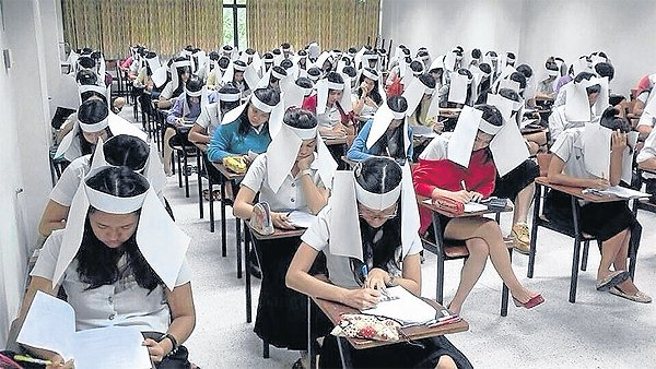 Students wear paper blinker