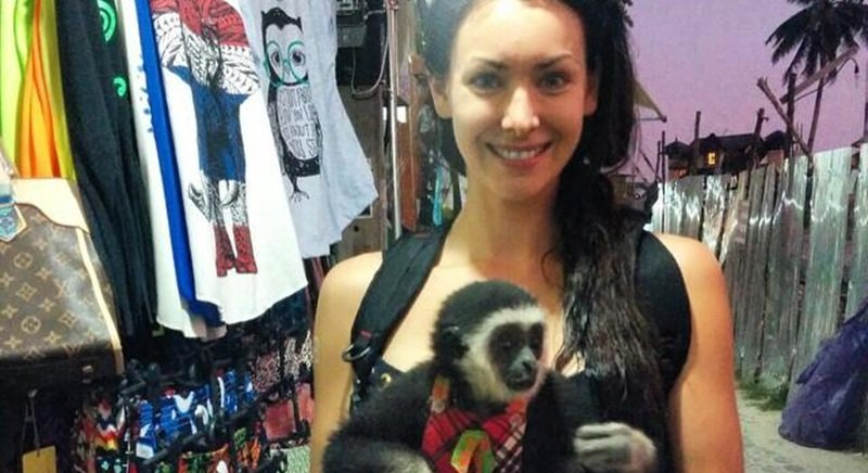 Natalie Glebova mugs with endangered gibbon