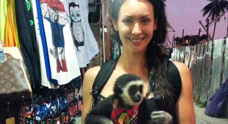 Natalie Glebova mugs with endangered gibbon