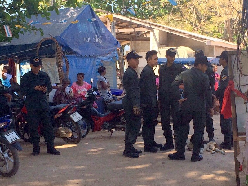 More than 50 officers from the Chalong Police, Royal Thai Navy and defense volunteers were called to sea gypsy village to keep the peace. Photo: Darawan Naknakhon