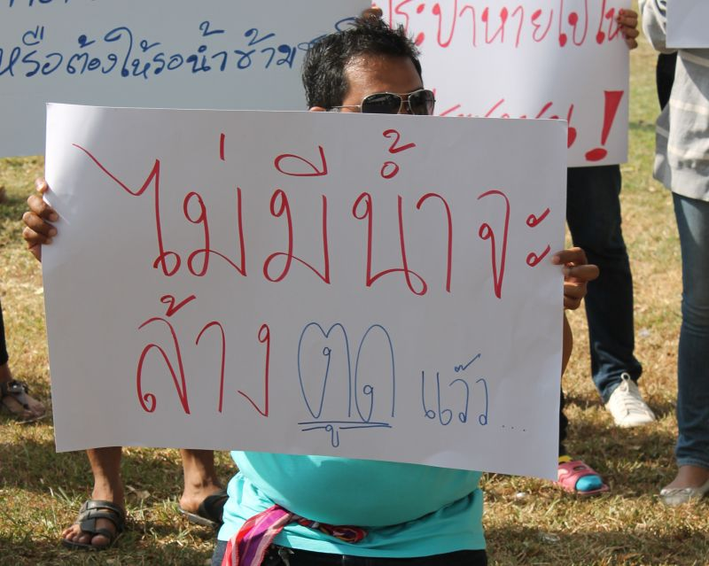 A Phuket resident protesting the water shortage last year holds a sign that reads