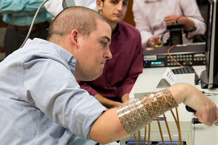 Ian Burkhart regained the use of his hand through neural bypass technology by AFP.