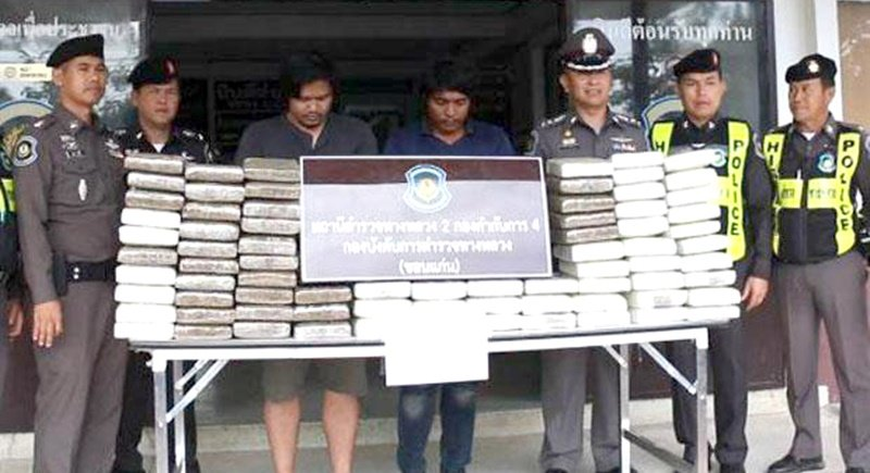 Highway police show the suspects with the 99 kilos of ganja. Photo: Jakkrapan Nathanri