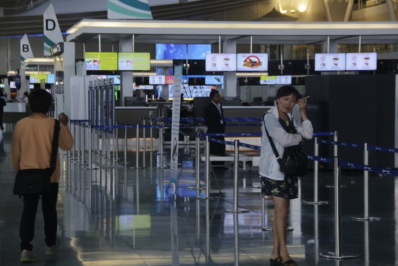 A woman waits inside the new International Terminal. Photos: Tanyaluk Sakoot