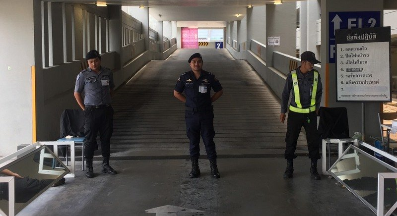 Security personnel carry out inspections of vehicles arriving at Phuket International Airport this morning (Oct 12). Photo: PIA