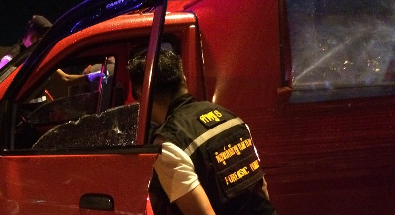 Bullet holes can be seen in the passenger window of Mr Sakol's vehicle. Photo: Eakkapop Thongtub