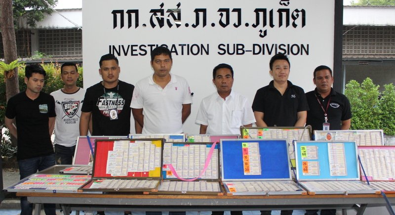 Officers at Phuket Provincial Police Station put on display lottery tickets seized from vendors charged with overcharging. Photo: Darawan Nakanakhon