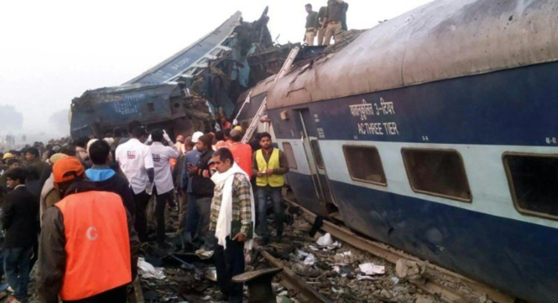 Indian rescue workers search for survivors in the wreckage of a train that derailed near Pukhrayan in Kanpur district. Photo: AFP