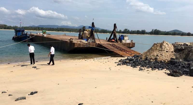 The workers said they built the earth ramp to make loading the artificial reef blocks easier. Photo: Eakkapop Thongtub