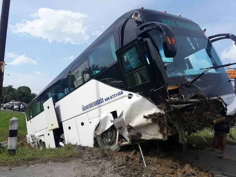 Three Russian tourists were taken to hospital after the Phuket-bound bus went off-road in Khok Kloi, Phang Nga. Photo: Eakkapop Thongtub