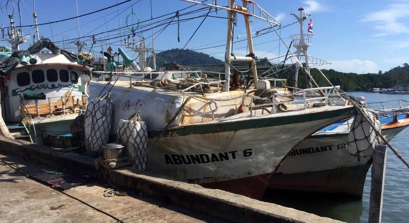 The seven suspected IUU fishing boats, falsely reported as registered in Bolivia, were seized at the Phuket's Sri Thai Pier in Rassada. Photo: Royal Thai Navy