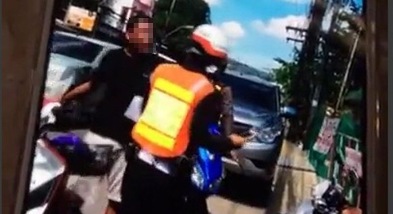 The man was seen on VDO hurling abuse at a traffic police officer. Photo: Eakkapop Thontub