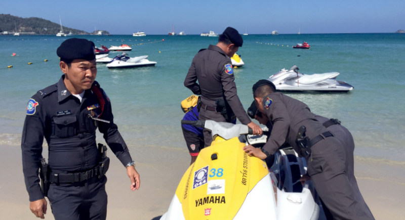 Phuket Tourist Police check that a jet-ski rented out to tourists is as legal as it can get. Photo: The Phuket News / file