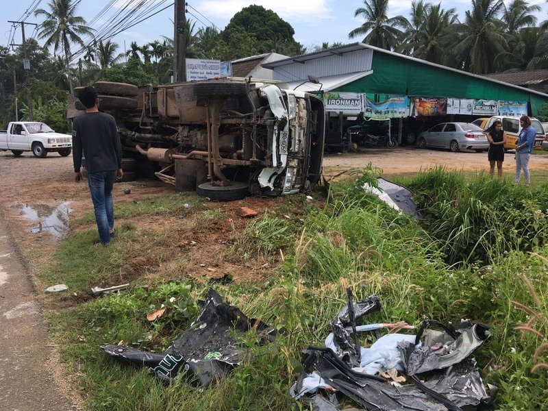 The truck flipped onto its side and slid out of control head-on into the oncoming traffic. Photo: Pornthep Bunsong