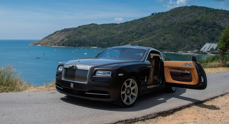 A two-door Rolls-Royce Wraith GT stands proud at the lookout overlooking Phuket's Nai Harn Bay. Photo: Rolls-Royce