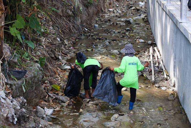 Workers clear the filthy Pakbang Canal, which runs through the heart of Patong. Photo: Patong Municipality