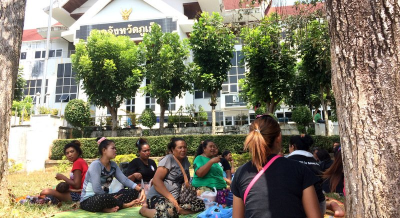 Sea gypsies gather in a show of support in front of Phuket Provincial Court. Photo: The Phuket News / file