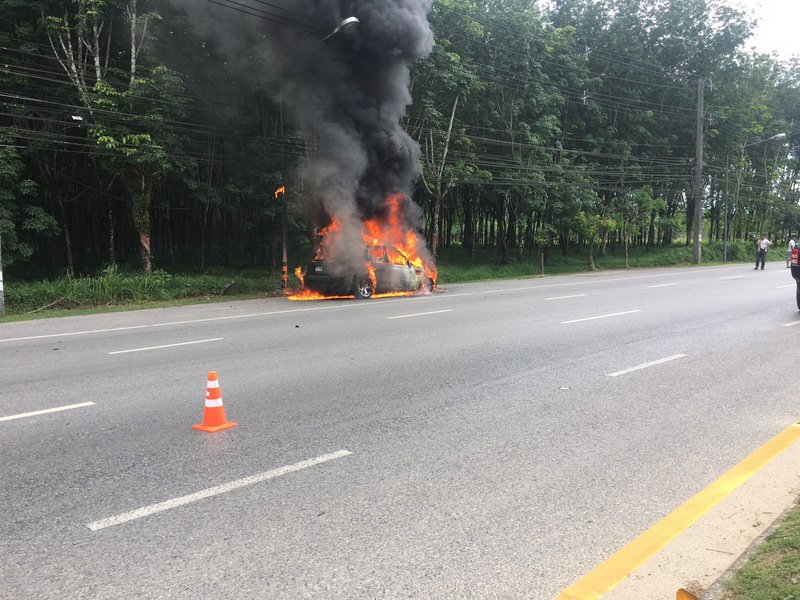 Firefighter doused the blaze, but not before the flames had gutted the Range Rover completely. Photo: Eakkapop Thongtub