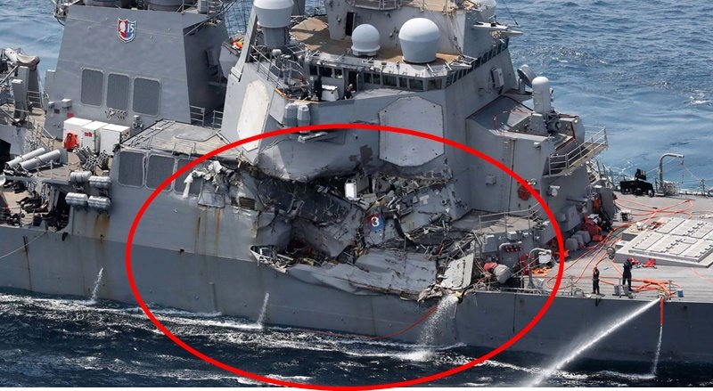Damage is seen on the guided missile destroyer 'USS Fitzgerald' off the Shimoda coast, after it collided with a Philippine-flagged container ship, on Saturday (June 17).  Photo: STR/ Jiji Press/AFP