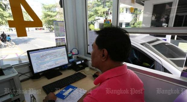 A Land Transport Department official checks vehicle registrations in Bangkok. The department has found that an Army colonel forged documents to seek registration of hundreds of suspicious vehicles in many provinces. Photo: Kitja Apichonrojarek / file