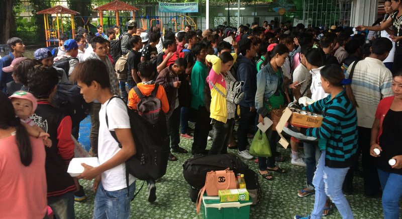 Hundreds of migrant workers sacked in the wake of the new labour law penalties have arrived in Phuket seeking help to get home to Myanmar. Photo: Eakkapop Thongtub