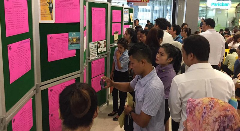 Job-seekers scour the boards at a job fair held at Central Festival Phuket East earlier this year. Photo: Supplied