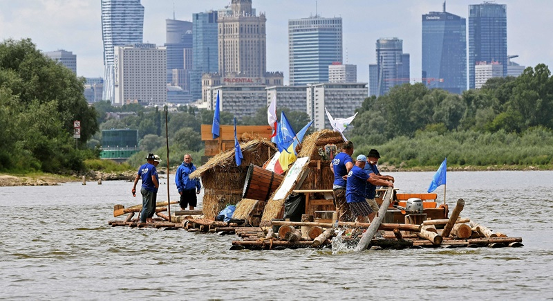 A group of Poles have assembled tree trunks into a long raft and are streaming down the country's longest river to revive the ancient tradition of timber floating. Photo: Janek Skarzynski/AFP