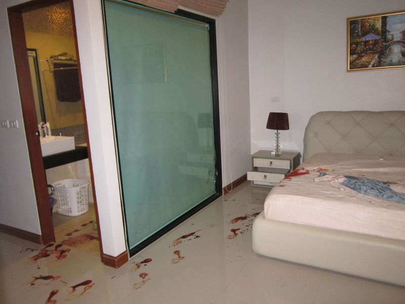 Ms Kharenko's bloody footprints led from the bathroom to the bedroom. Photo: Chalong Police