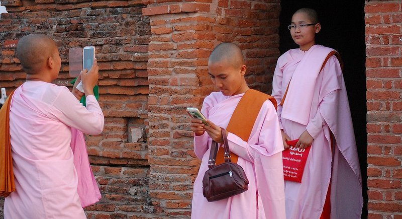 Buddhist nuns and their phones in Myanmar. Photo: Lirneasia