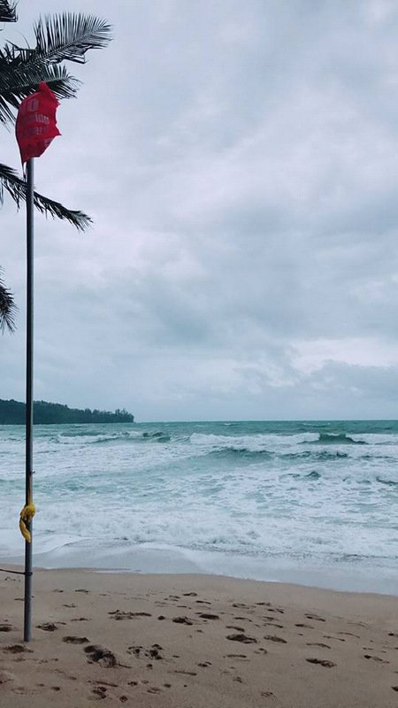 Lifeguards have posted red 'No Swimming' flags where it is dangerous to enter the water at at Kamala Beach. Photo: Phuket Lifeguard Service