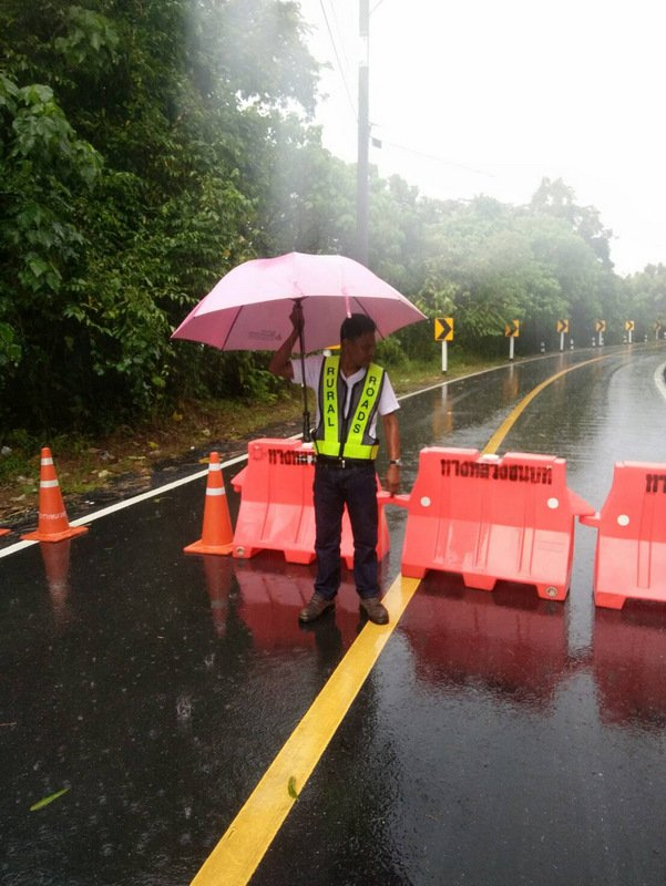 The road was closed for hours while workers cleared the landslide debris are reparied the downed power cables. Photo: PR Dept