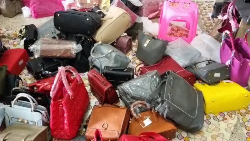 At the house police found many counterfeit bags including brand names such as Chanel, Louis Vuitton, Hermes and Coach. Photo: Narongsak Sangsridam