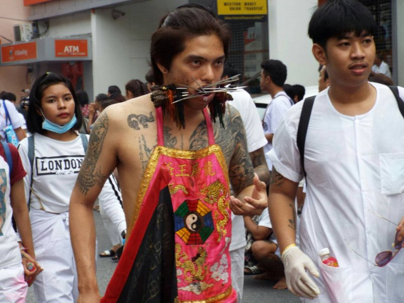 The more familiar sights of the Phuket Vegetarian Festival wound their way through the streets of Phuket Town yesterday morning (Nov 12). Photo: Eakkapop Thongtub
