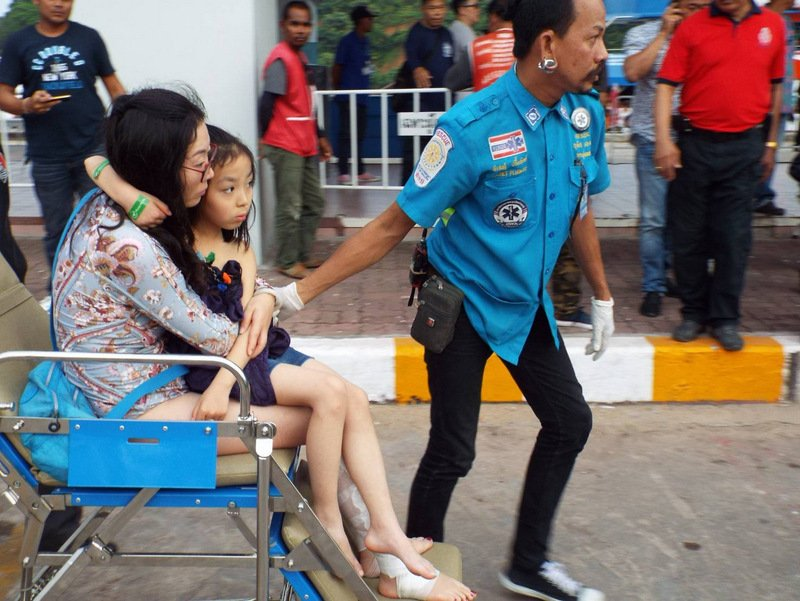The injured tourists were brought ashore yesterday. Three of them remain in intensive care. Photo: Eakkapop Thongubt