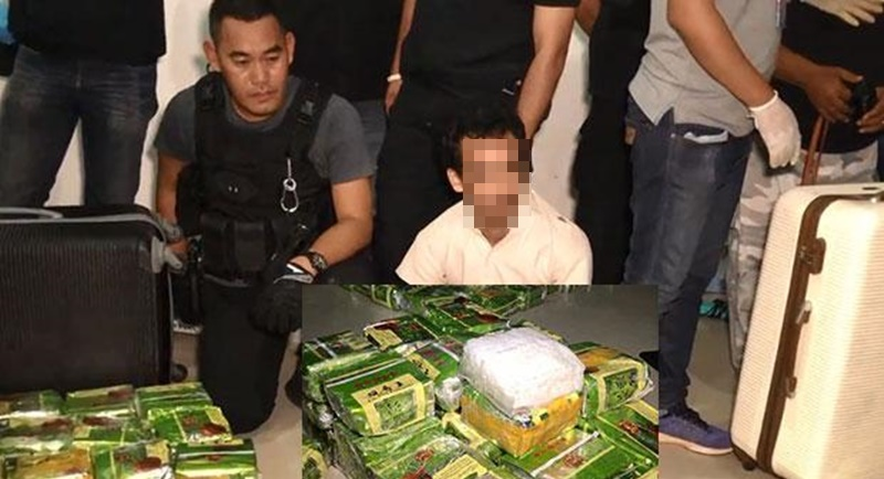 Drug suspect Paisarn Thonthammachart, 29, is caught and 123kg of crystal meth found in three travelling bags seized during a raid on his hiding place in Sadao district and a rented house where the drugs are kept in Hat Yai district, Songkhla, yesterday night (Feb 9). Photo: screengrab from video taken by Assawin Pakkawan