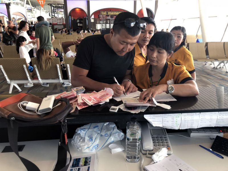 Chinese national Li Xiaofei claims back his possessions. Photo: Phuket International Airport