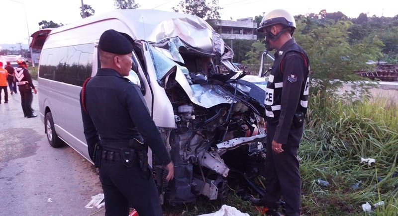 Police inspect the damaged minivan at the scene. Photo: Eakkapop Thongtub