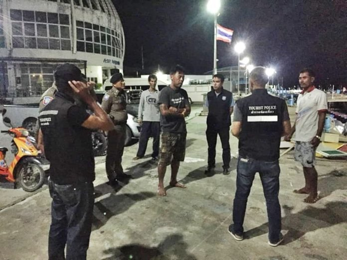 The tourists and crewmen were brought safely ashore at the Asia Marina Pier in Rassada in Phuket at 5am. Photo: Tourist Police.