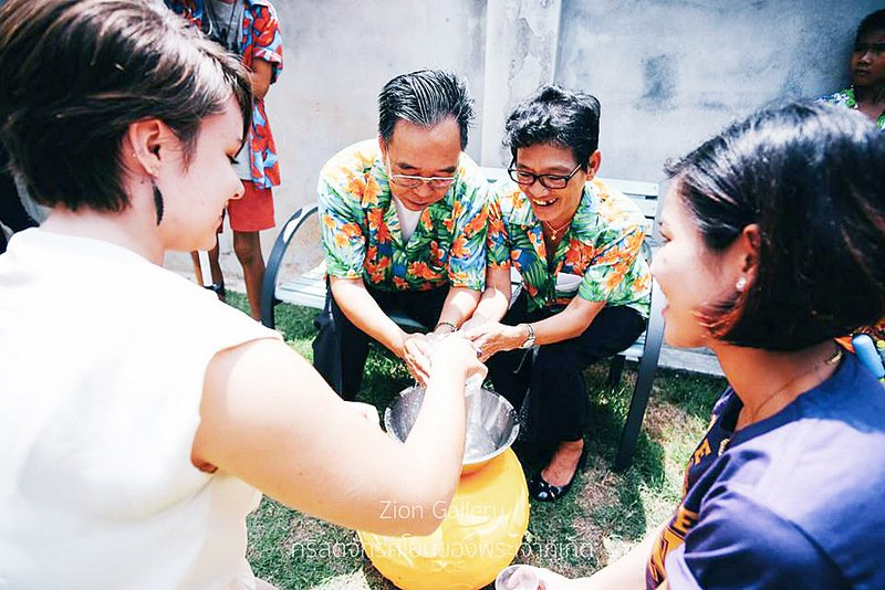 Wearing colourful clothes and ritually pouring water over the hands of senior family members are the hallmarks of modern Songkran celebrations. Photo: Zion Gallery