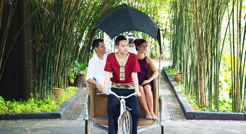 Guests at Anantara Mai Khao Phuket take a rickshaw tour of the resort's beautifully designed grounds. Photo: Anantara
