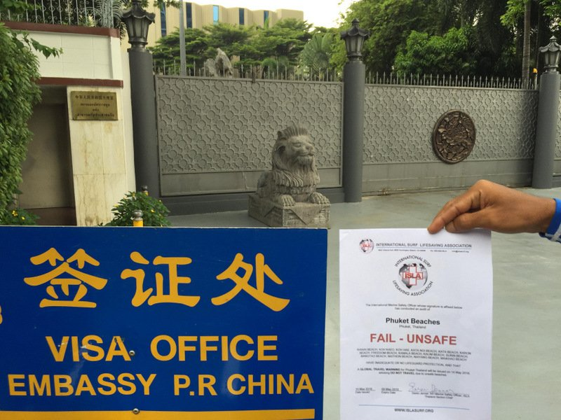 A copy of the ISLA beach safety audit for Phuket held up outside the Chinese Embassy in Bangkok today (May 15).