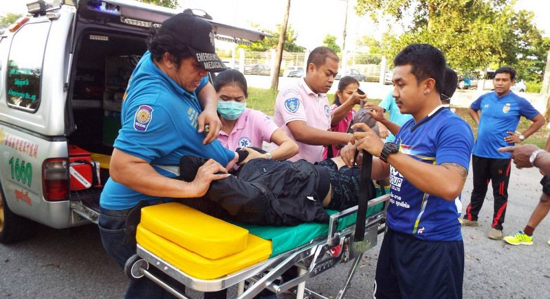 Rescue workers attend to the woman as they take her to Thalang Hospital. Photo: Eakkapop Thongtub