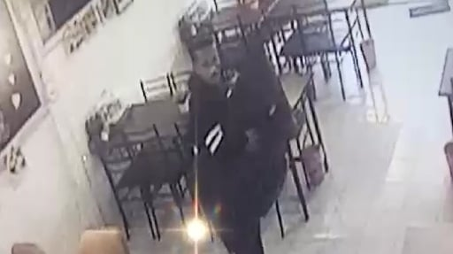 Police search for man in black over bold restaurant TV theft