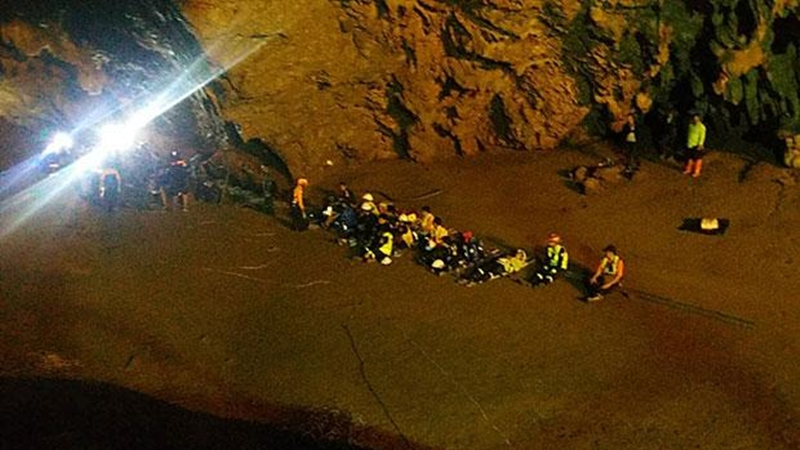 Rising water obstructs cave search of trapped students, coach