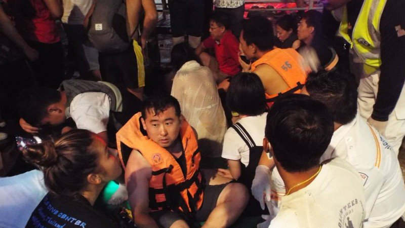 One dead, dozens of tourists feared missing as Thai boat capsizes