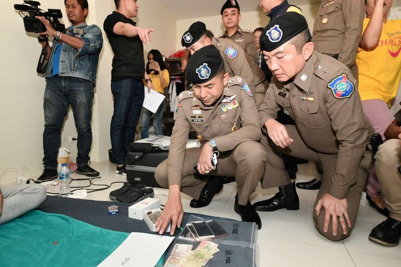 Some 135 credit cards, six ATM cards and 52 mobile SIM cards were seized in the raids. Photo: Tourist Police