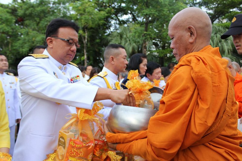 The merit-making event included making offerings to monks. Photo: PR Dept